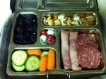Tuesday: nitrate-free ham and salami, blackberries, carrots and cucumbers, mixed nuts and seeds, and a few M&Ms