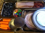 blueberries, nitrate free ham and pepperoni, carrots with ranch, strawberry greek yogurt, m&m's for treat